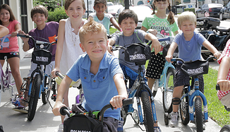 Kids enjoy a special bike rodeo.